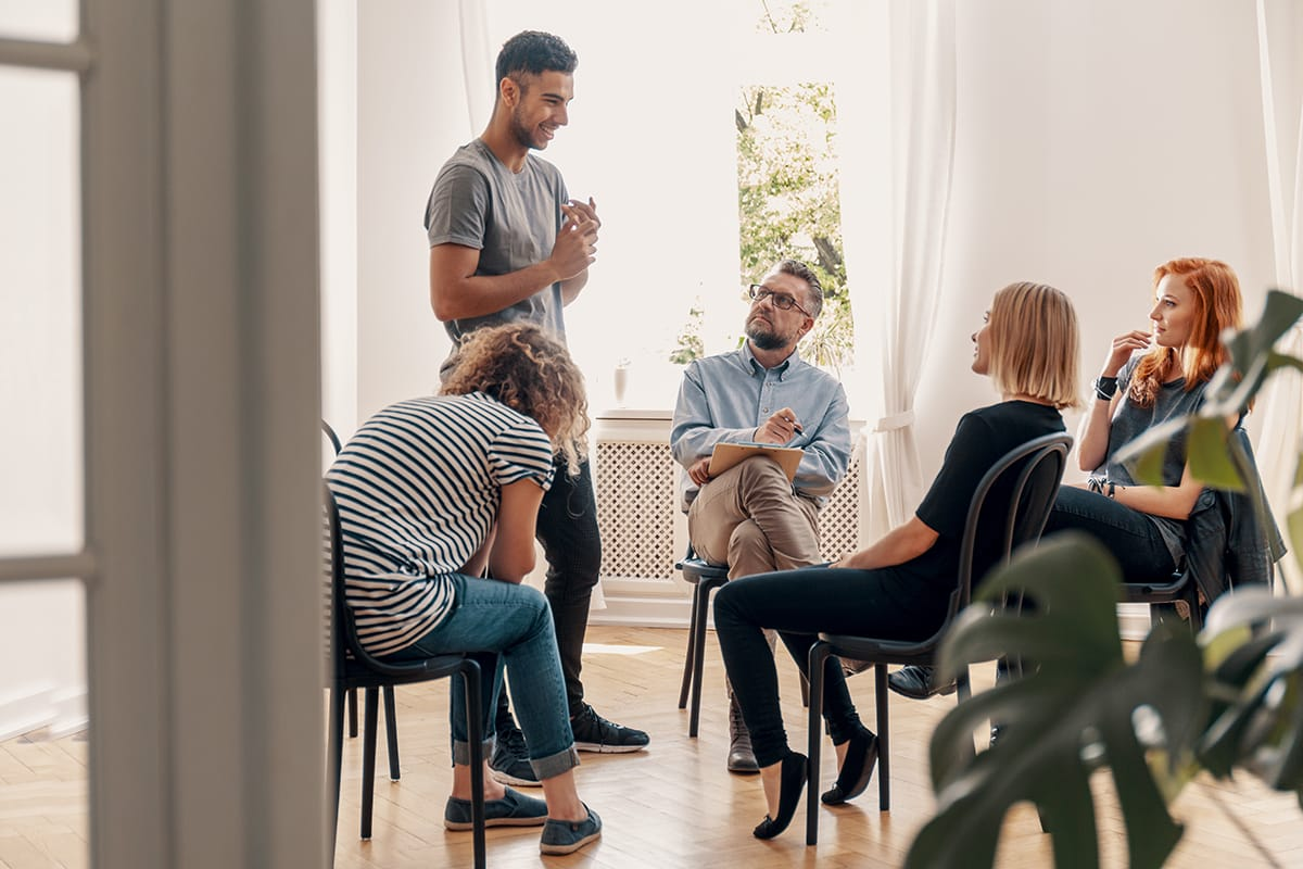 Man participating in group therapy activities