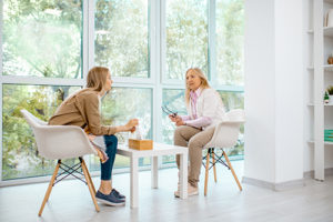Patient and therapist speaking at an anxiety treatment center