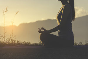 Woman participating in her meditation therapy program