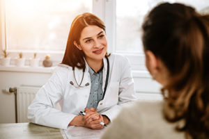 a doctor talking to a patients family about attending a heroin detox center