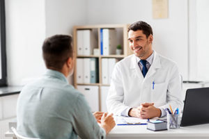 a doctor talking to his patient about his time at mens alcohol rehab center