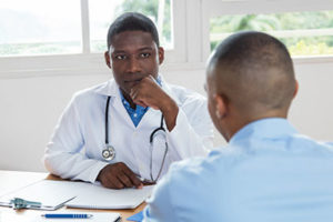 a doctor making the expert decision that his patient should attend a mens drug rehab center