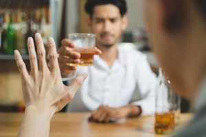 man after the alcohol rehab program Boston refusing a drink thanks to the alcohol rehab center in Boston