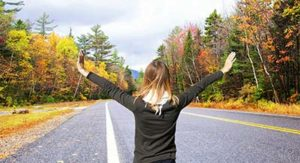 woman outstretching hands on road to Massachusetts addiction treatment centers for drug and alcohol addiction treatment centers MA