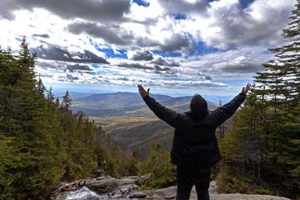new hampshire addiction recovery center patient with arms outstretched in the mountains near the drug addiction recovery center nh